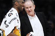 Bill chats with Kobe Bryant of the Los Angeles Lakers during a break at a game.