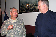 Bill interviews military men in Afghanistan.