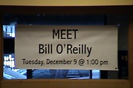 The store staff hung a banner to welcome Bill and to announce the event to store patrons.