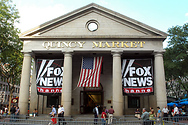 Banners for the Fox News Channel fly outside Quincy Market across from Faneuil Hall.