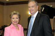 Bill poses for a quick photo with Senator Clinton following his interview.